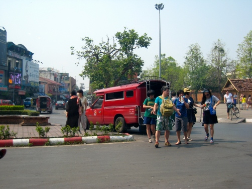 Chinese tourists hop out of a jitney