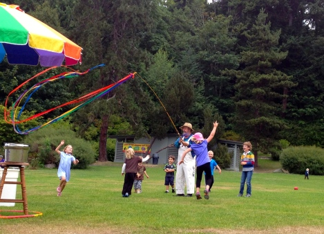 "Bubble Man playing ""chase the rainbow"" with children at Seattle's Carkeek Park"