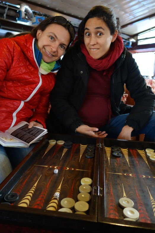 Playing backgammon with my two friends. This round the photographer (me) happens to be winning!