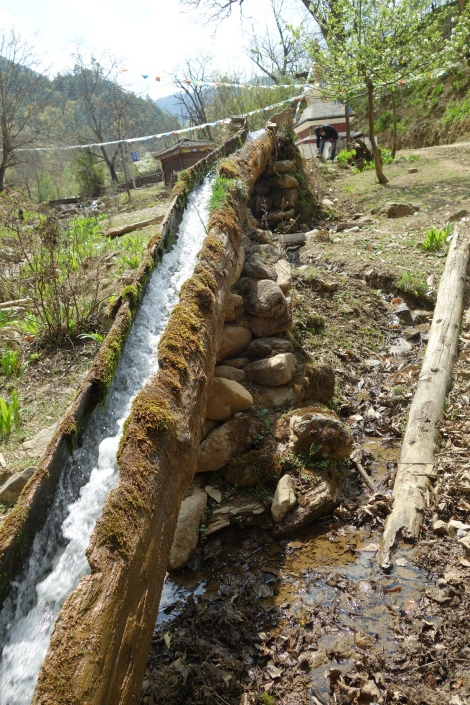 Hollowed-out log diverting water from the stream to the mill.