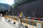 Construction worker outside of City of Dreams Macau _ expatlingo.com