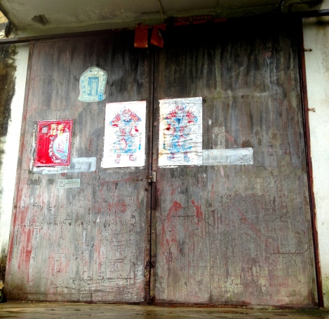 "Warriors posted on doors of old ""Tai Wah Plastic Leather Factory."""