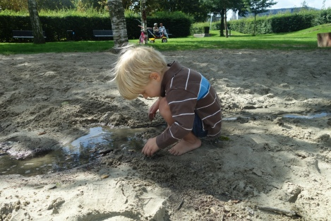 Not actually his nursery, but it could just as well be: lots of self-exploration, sand and water.