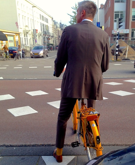 The New Normal. Yes, his socks match his bike. (And I need to improve my street photography)