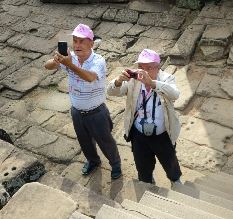 These two gentlemen were part of a large tour group out of China. Yes, they all wore matching pink caps. And they were all smiles despite it.