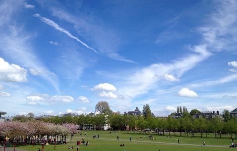 Blue skies above Amsterdam's Museumplein _ expatlingo.com