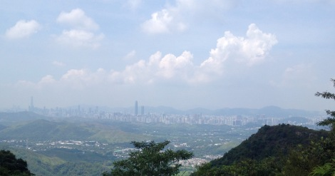 See the wall of buildings sprouting up after the rolling hills of green? That is Shenzhen as viewed from northern Hong Kong.